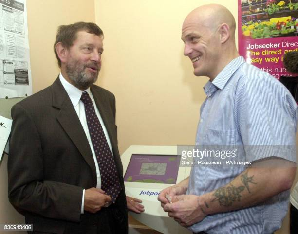 Home Secretary David Blunkett meets inmate Tony Lock at Lewes Prison in East Sussex where the first touchscreen computers giving inmates access to...