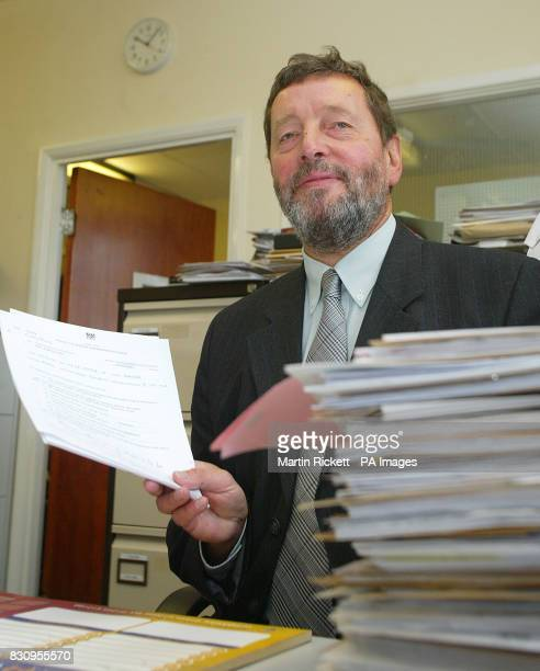 Home Secretary David Blunkett sits with a pile of police paperwork during his visit to Chester Police Station in Cheshire Mr Blunkett was today...