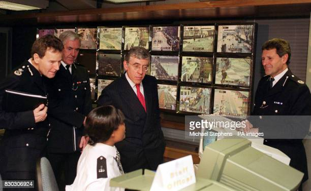 Home Secretary Jack Straw accopmpanied by Metropolitan Police Commissioner Sir Paul Condon talks to police officers manning the Met Police Control...
