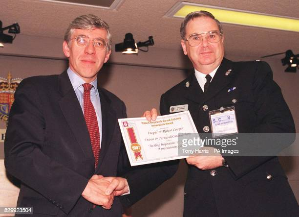 Home Secretary Jack Straw presents Inspector Robert Cooper of the Devon and Cornwall Constabulary with a certificate to mark the announcement today...
