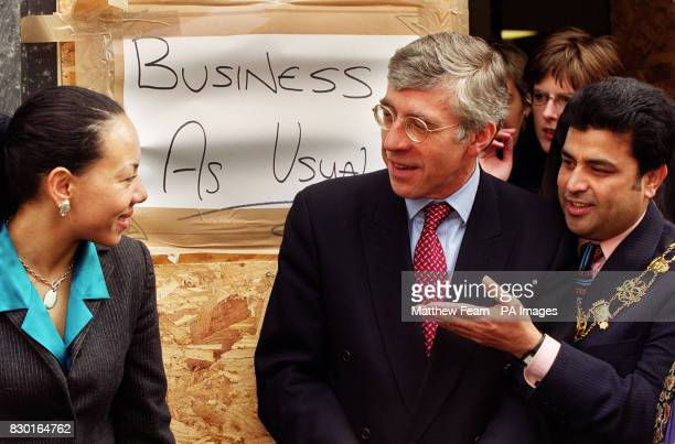 Home Secretary Jack Straw speaks to Bethnal Green and Bow MP Oona King and Tower Hamlets Lord Mayor Abdul Assad at the scene of the nail bombing...