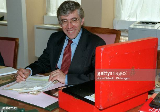 Home Secretary Jack Straw with his ministerial box at the Home Office this afternoon Mr Straw today praised the civil service for the smooth...