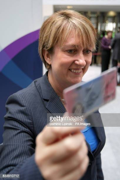 Home Secretary Jacqui Smith holds an example of a new identity card at a press conference at the Home Office Westminster central London