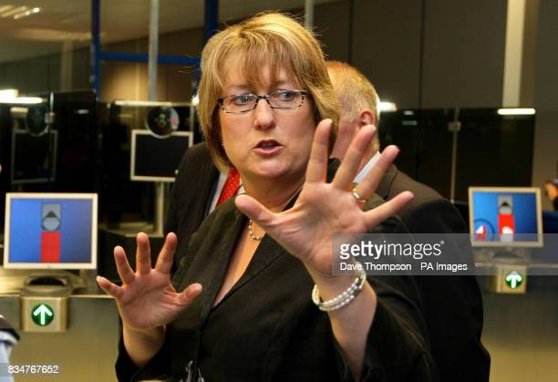 Home Secretary Jacqui Smith is shown the new facial recognition system at Manchester Airport