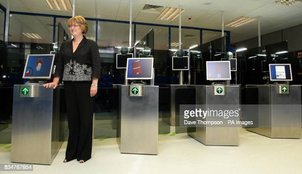 Home Secretary Jacqui Smith stands by the new facial recognition system at Manchester Airport