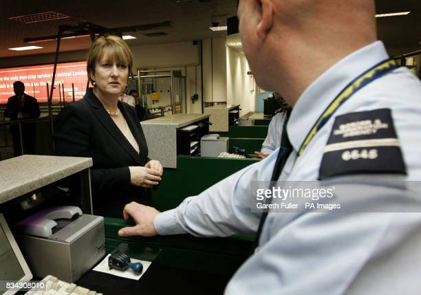 Home Secretary Jacqui Smith talking to staff at passport control during the official launch of the UK Border Agency at Gatwick Airport in West Sussex