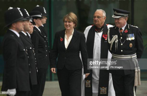 Home Secretary Jacqui Smith The Reverend Canon Barry Wright and Metropolitan Police Commissioner Sir Ian Blair walk to talk with police officers at...
