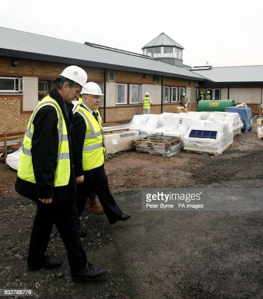 Home Secretary John Reid is given a guided tour of the site for a new prison on Merseyside PRESS ASSOCITION Photo