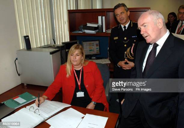 Home Secretary John Reid meets DC Mel Moody of the City Of London Police's Econmic Crime Unit during a visit to the Unit based near Bank London