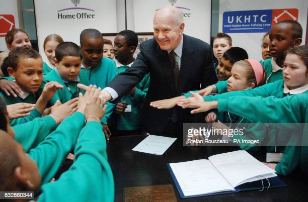 Home Secretary John Reid shakes hands with Newham schoolchildren after signing the Council of Europe's Convention on Action Against Human Trafficking...