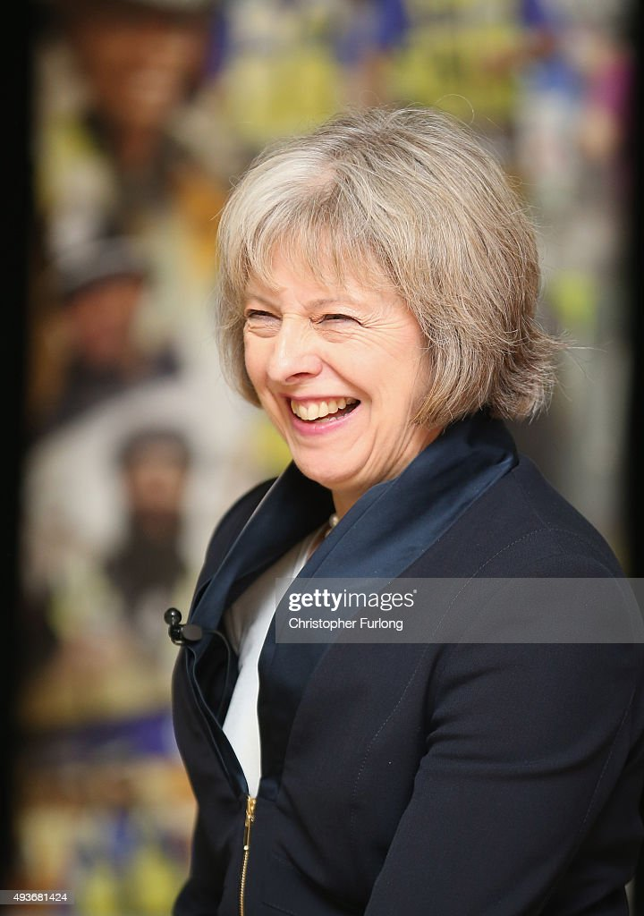Home Secretary <a gi-track='captionPersonalityLinkClicked' href=/galleries/search?phrase=Theresa+May&family=editorial&specificpeople=832274 ng-click='$event.stopPropagation()'>Theresa May</a> addresses delegates during the National Black Police Association (NBPA) Conference at Tally Ho Conference Centre on October 22, 2015 in Birmingham, England. During her speech <a gi-track='captionPersonalityLinkClicked' href=/galleries/search?phrase=Theresa+May&family=editorial&specificpeople=832274 ng-click='$event.stopPropagation()'>Theresa May</a> condemed the lack of police officers from minorities in British police forces.