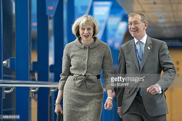 Home Secretary Theresa May and her husband Philip arrive to listen to Prime Minster David Cameron's keynote address on the final day of the annual...