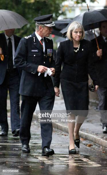 Home Secretary Theresa May arrives at the Funeral of Pc Andrew Duncan with Met Police Commissioner Sir Bernard Hogan Howe The funeral was held at St...