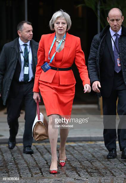 Home Secretary Theresa May arrives for the fourth and final day of the Conservative Party Conference at Manchester Central on October 7 2015 in...