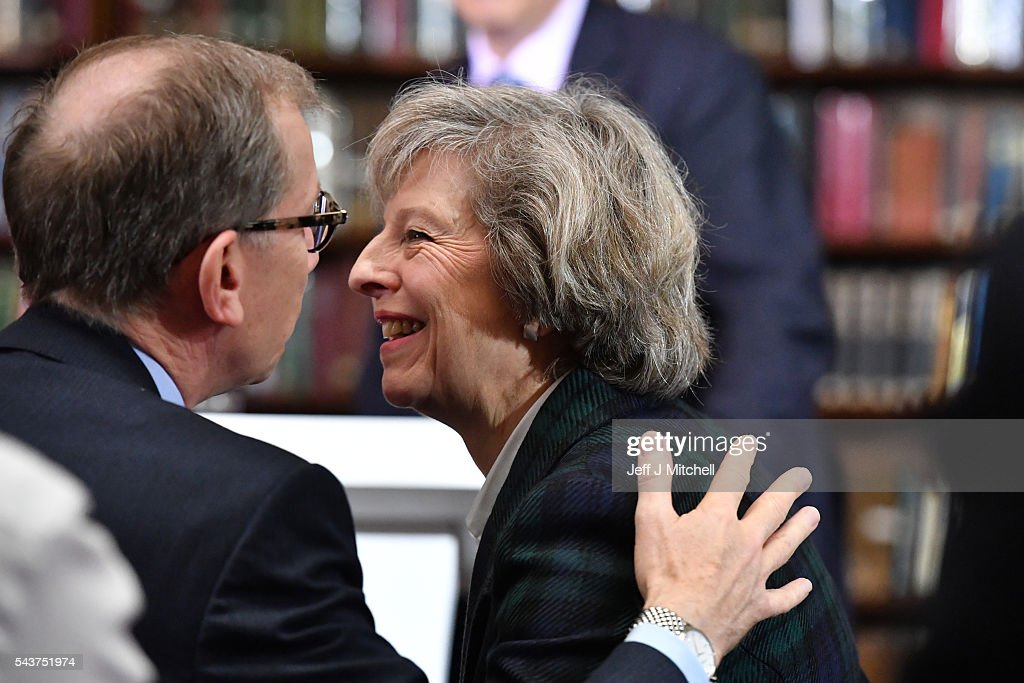 Home Secretary <a gi-track='captionPersonalityLinkClicked' href=/galleries/search?phrase=Theresa+May&family=editorial&specificpeople=832274 ng-click='$event.stopPropagation()'>Theresa May</a> is greeted before speaking to launch her bid to become the next Conservative party leader at RUSI Whitehall on June 30, 2016 in London, England. Nominations for MP s to declare their intention to run for the Conservative Party Leadership and therefore British Prime Minister will close by noon today. The current Prime Minister and party leader, David Cameron, announced his resignation the day after the UK voted to leave the European Union.