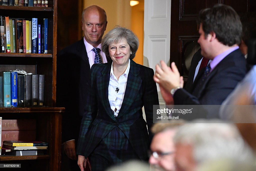 Home Secretary <a gi-track='captionPersonalityLinkClicked' href=/galleries/search?phrase=Theresa+May&family=editorial&specificpeople=832274 ng-click='$event.stopPropagation()'>Theresa May</a> is greeted before speaking to launch her bid to become the next Conservative party leader as Chris Grayling, Lord President of the Council, Leader of the House of Commons walks behind her at RUSI Whitehall on June 30, 2016 in London, England. Nominations for MP s to declare their intention to run for the Conservative Party Leadership and therefore British Prime Minister will close by noon today. The current Prime Minister and party leader, David Cameron, announced his resignation the day after the UK voted to leave the European Union.