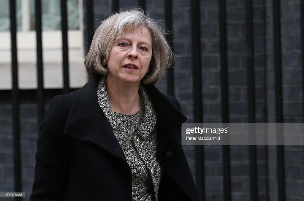 Home Secretary <a gi-track='captionPersonalityLinkClicked' href=/galleries/search?phrase=Theresa+May&family=editorial&specificpeople=832274 ng-click='$event.stopPropagation()'>Theresa May</a> leaves Downing Street after attending a cabinet meeting on March 24, 2015 in London, England. This is the last government cabinet meeting to be held before Parliament ends for general election campaigning to begin on March 30, 2015.