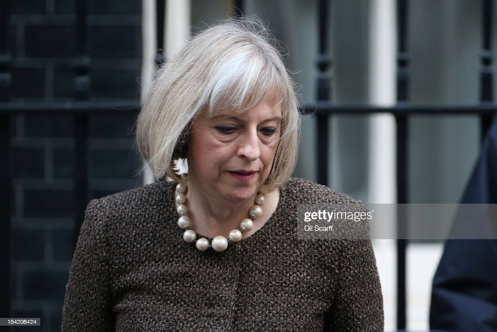 Home Secretary Theresa May leaves Number 10 Downing Street after attending the weekly Cabinet meeting on October 16, 2012 in London, England. Home Secretary Theresa May will decide today on whether to extradite computer hacker Gary McKinnon, who suffers from Asperger's Syndrome, to the United States for illegally accessing dozens of military computers.