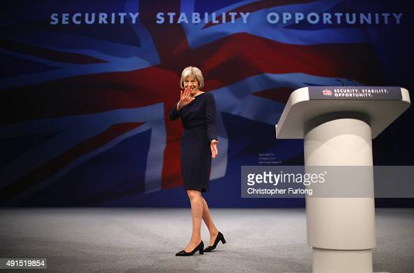 Home Secretary Theresa May leaves the stage after delivering her keynote speech to delegates during the Conservative Party Conference on October 6...