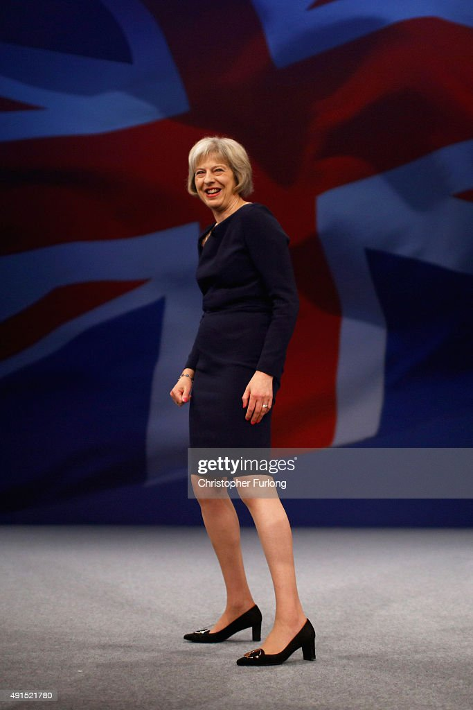 Home Secretary <a gi-track='captionPersonalityLinkClicked' href=/galleries/search?phrase=Theresa+May&family=editorial&specificpeople=832274 ng-click='$event.stopPropagation()'>Theresa May</a> leaves the stage after delivering her keynote speech to delegates during the Conservative Party Conference on October 6, 2015 in Manchester, England. Home Secretary <a gi-track='captionPersonalityLinkClicked' href=/galleries/search?phrase=Theresa+May&family=editorial&specificpeople=832274 ng-click='$event.stopPropagation()'>Theresa May</a> addressed delegates on day three of the Conservative Party conference at Manchester Central and warned that it is 'impossible to build a cohesive society' and the UK needs to have an immigration limit.