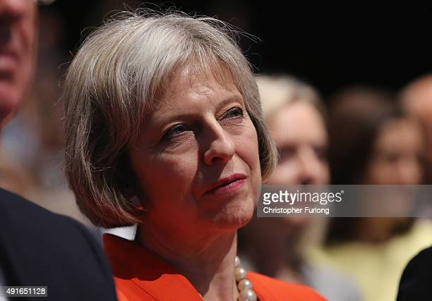 Home Secretary Theresa May listens to Prime Minister David Cameron deliver his keynote speech to delegates on the fourth and final day of the...