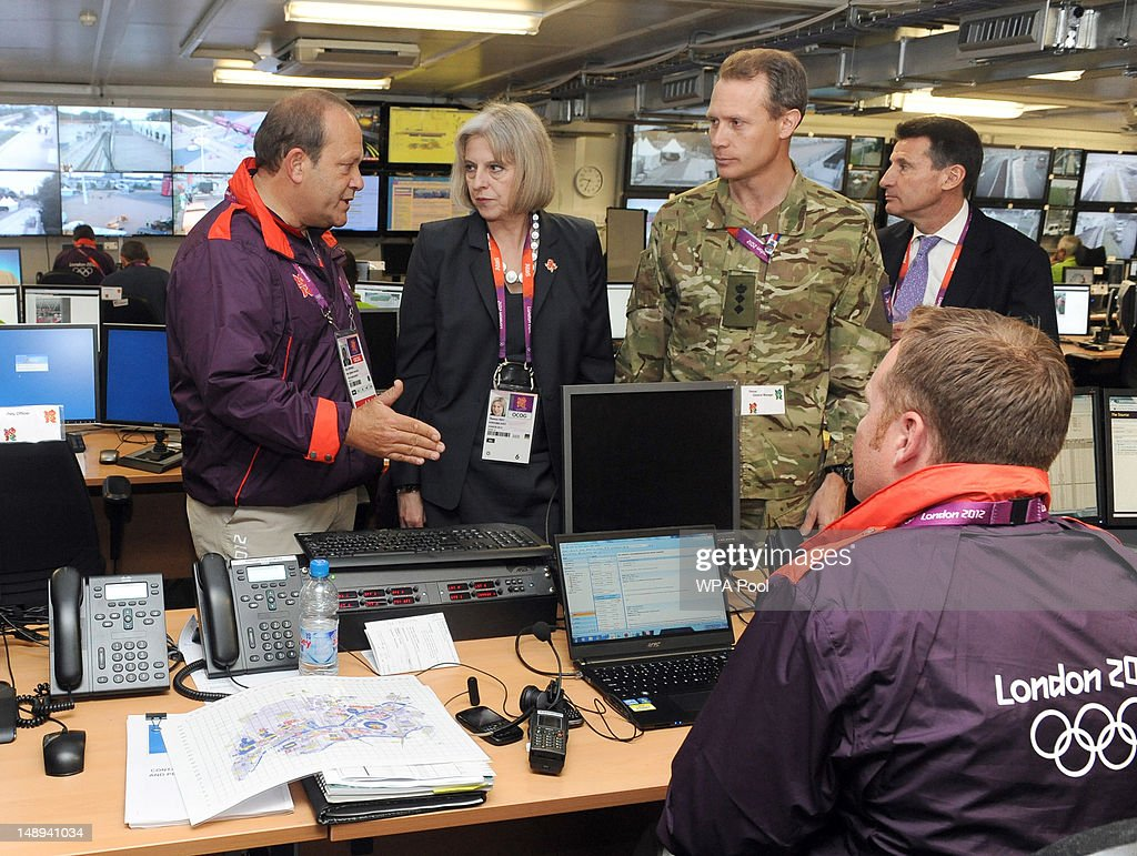 Home Secretary Theresa May speaks with (L-R) Clive Stevens, venue general manager of the Olympic Park, Colonel Gary Wilkinson and LOCOG Chairman Lord Coe during a visit to the Olympics security control room, in the Olympic park, Stratford, on July 20, 2012 in London, England. During her visit, May stated that G4S - the world's second largest private sector employer - informed her last month that they would resolve issues and supply a sufficient number of Olympic guards.