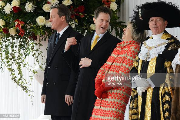 Home Secretary Theresa May stands with Prime Minister David Cameron and Deputy Prime Minister Nick Clegg before the arrival of the President of...