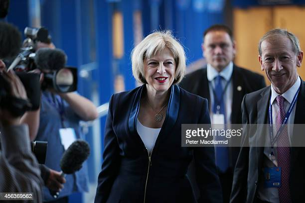 Home Secretary Theresa May walks to the Conservative party conference on September 30 2014 in Birmingham England The third day of conference will see...