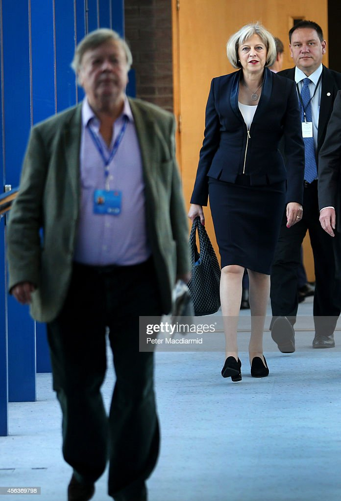 Home Secretary Theresa May walks to the Conservative party conference behind former cabinet minister Ken Clarke on September 30 2014 in Birmingham...