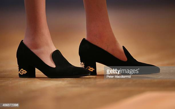 Home Secretary Theresa May wears black shoes with a gold pattern on the heel as she addresses the Conservative party conference on September 30 2014...