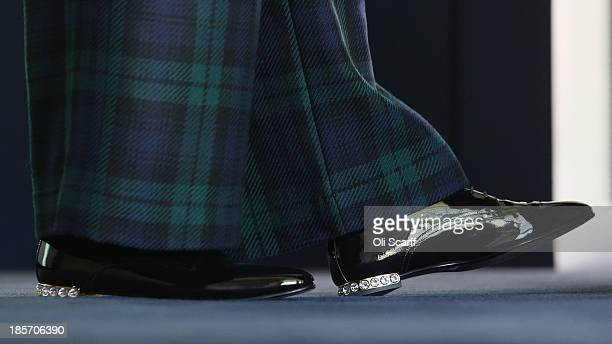 Home Secretary Theresa May's shoes as she addresses The College of Policing Conference on October 24 2013 in Bramshill near Hook England In her...