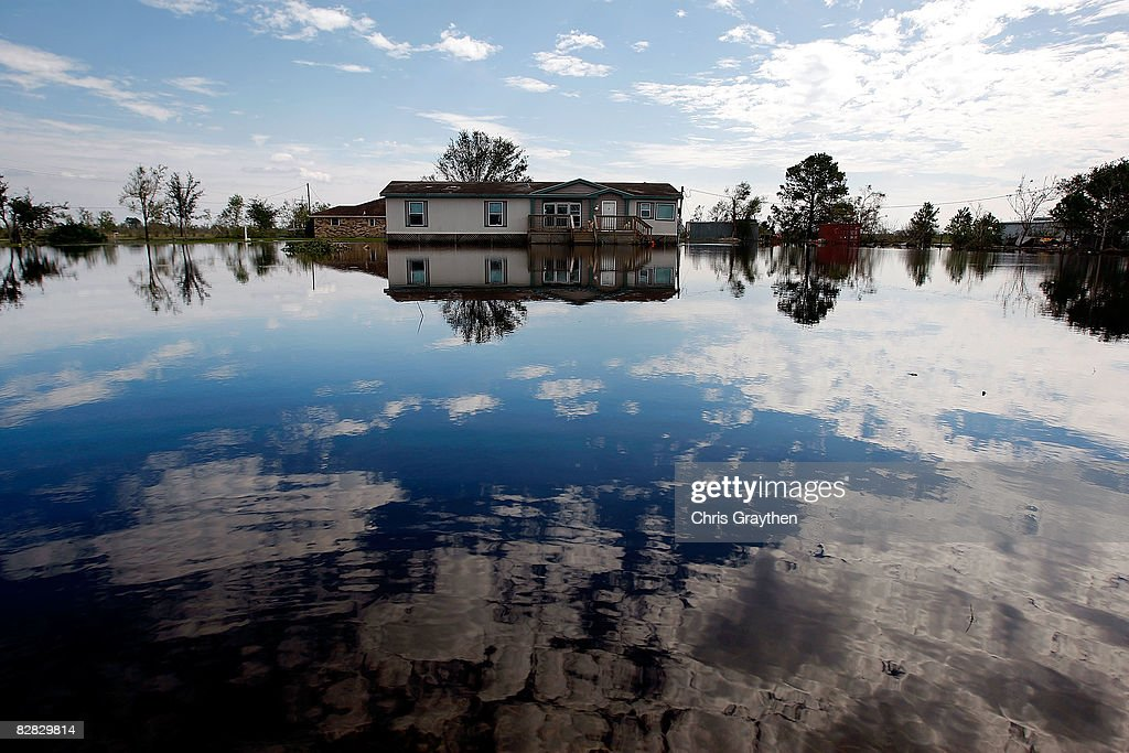 A home sits surrounded by water on a flooded farm after Hurricane Ike hit September 15, 2008 in Winnie, Texas. Ike caused extensive damage along the Texas Gold Coast, leaving millions without power.