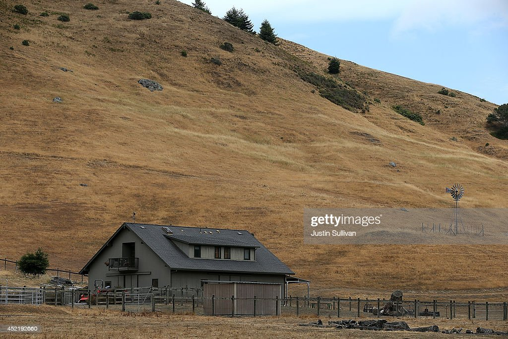 A home stands next to a hill that is brown with dead grass on July 15, 2014 in Nicasio, California. As the severe drought in California contiues to worsen, the State's landscape and many resident's lawns are turning brown due to lack of rain and the discontinuation of watering.