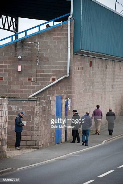 Home supporters making their way along Wilkie Road at Barrow AFC's Furness Building Society Stadium prior to the delayed kickoff of the Barrow v...