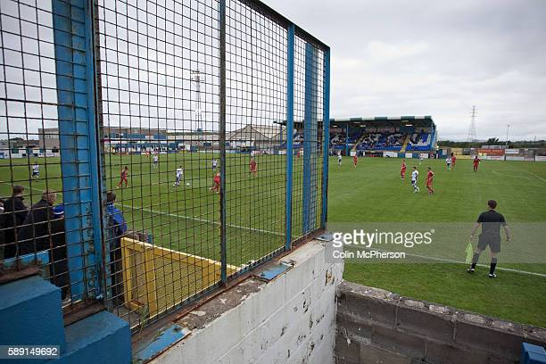 Home supporters watching the action from the Popular Side at Barrow AFC's Furness Building Society Stadium during the Barrow v Newport County...