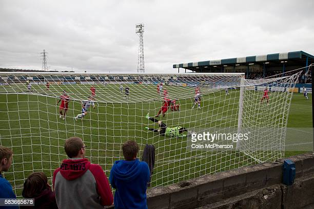 Home supporters watching the action from the terracing behind the goal at Barrow AFC's Furness Building Society Stadium during the Barrow v Newport...