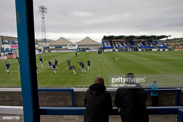 Home supporters watching their team warming up on the Popular Side terracing at Barrow AFC's Furness Building Society Stadium prior to the delayed...