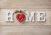 """Wooden """"home"""" text on vintage board with copy space"""