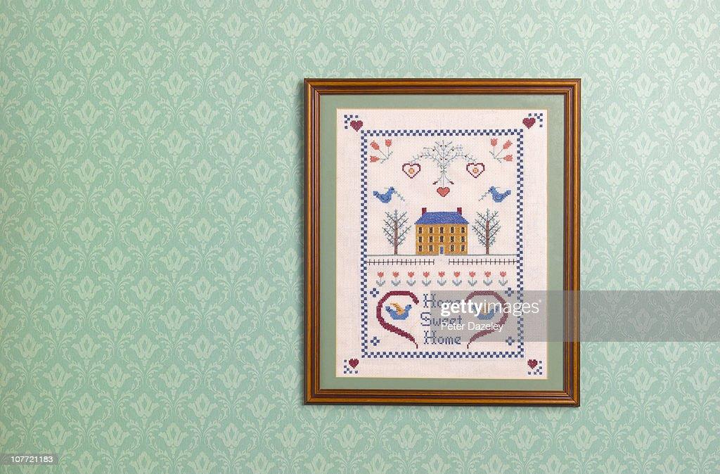 Home sweet home sampler against wallpaper