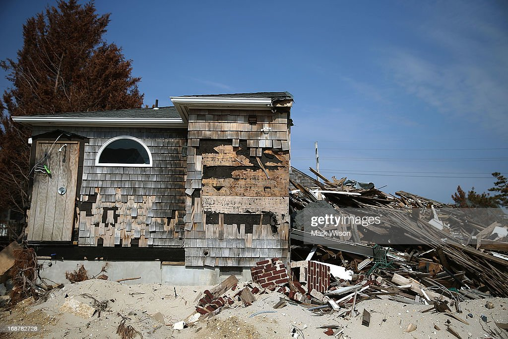 A home that was damaged by Superstorm Sandy and is sheduled to come down and be hauled away, May 15, 2013 in Manotoloking, New Jersey. Mantoloking officials say that at least 50 homes are scheduled to be demolished in the up coming weeks.