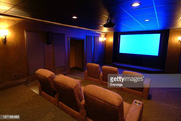 Home theater room with blue screen
