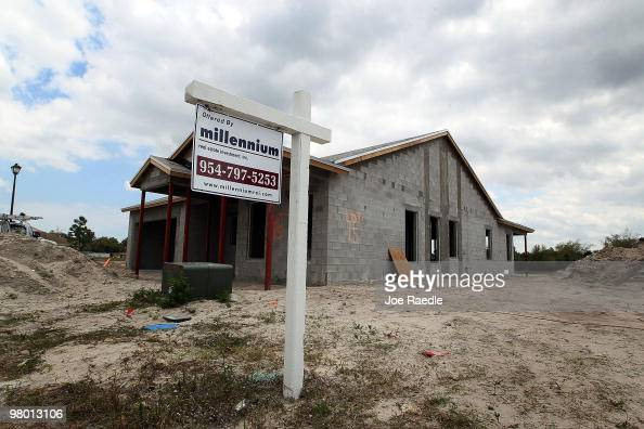 A home under construction sits near a for sale sign on March 24 2010 in Davie Florida The Commerce Department announced that new home sales fell 22...