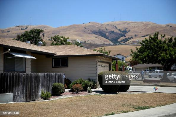 A home with a dead lawn stands in front of hills that are browned with dried grass on July 18 2014 in Fremont California As the severe drought in...