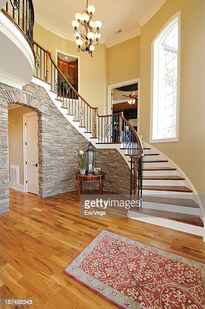 Home with large wooden stair case