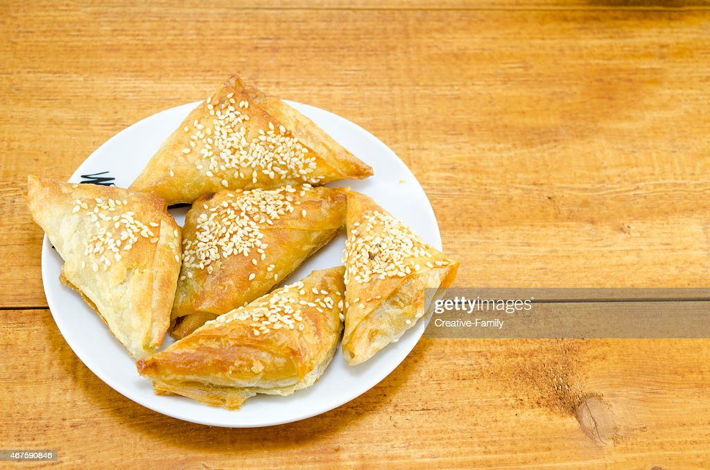 Homebaked triangle shaped meat pie on a plate  Stock Photo & Homebaked Triangle Shaped Meat Pie On A Plate Stock Photo | Thinkstock
