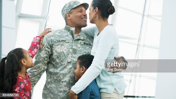 Homecoming of US Military Soldier kissing his wife in airport