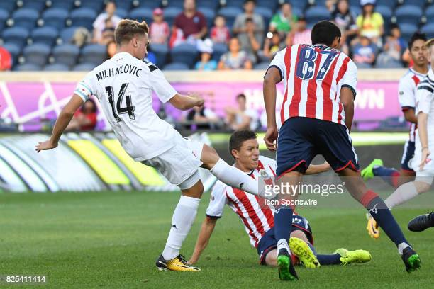 Homegrown and Chicago Fire midfielder Djordje Mihailovic scores a goal in the first half during a soccer match between the MLS Homegrown Team and the...