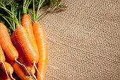 Homegrown Baby Carrots on Burlap Background