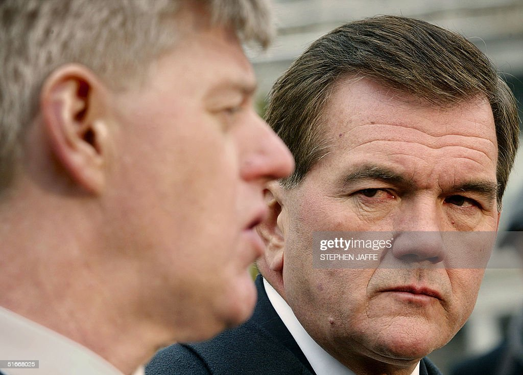Homeland Security Advisor and SecretaryDesignate Tom Ridge looks at Deputy Prime Minister of Canada John Manley as they speak to the media outside...
