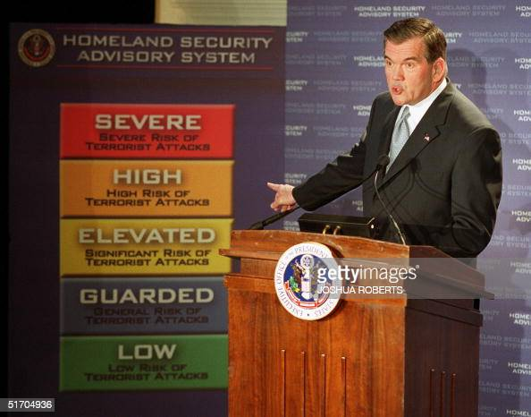 Homeland Security Chief Tom Ridge points to a new colorcoded US threat advisory system 12 March 2002 in Washington DC which will allow the government...